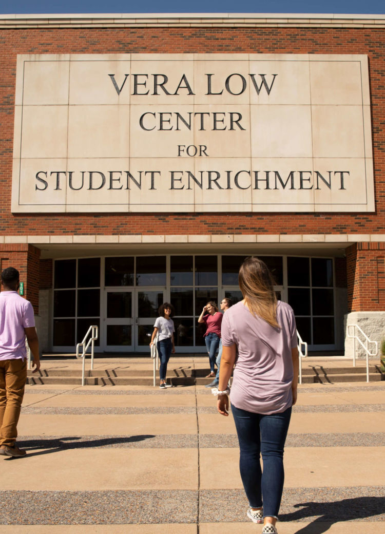 students walking in front of the Vera Low Center on campus