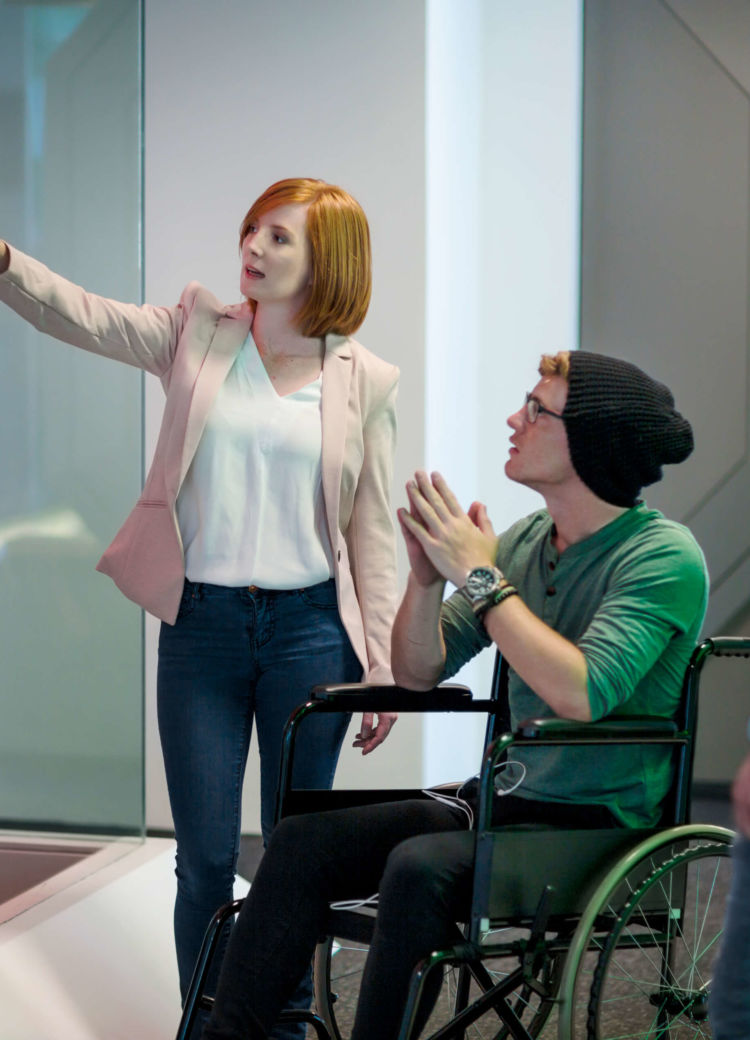 a university faculty member meets with a disabled student