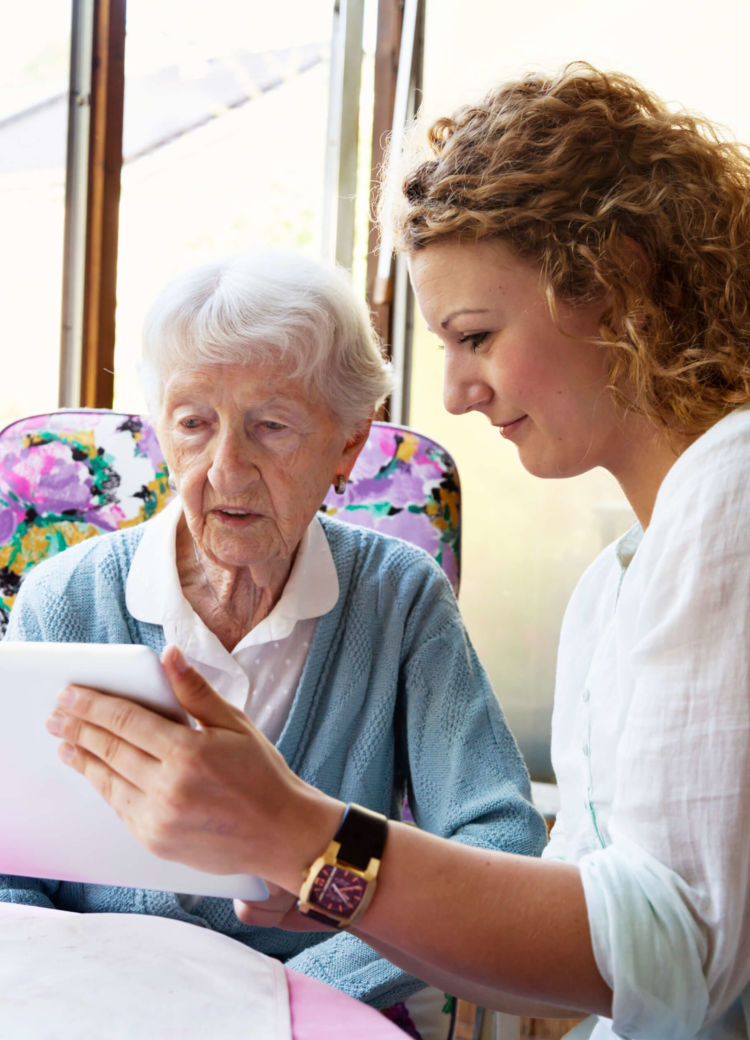 a social worker helps assist an elderly woman