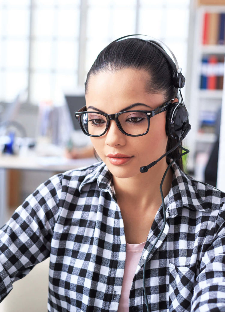 a customer representative talks on the phone with a client
