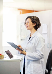 a physician assistant works on a chart in a lab