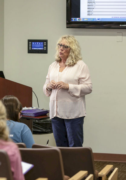 a female professor gives a lecture
