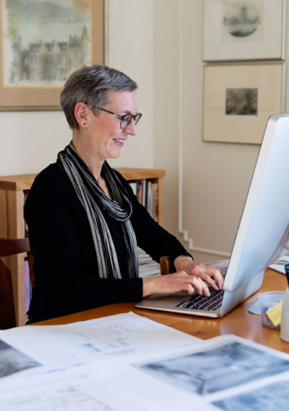 an historian conducts some research from her office