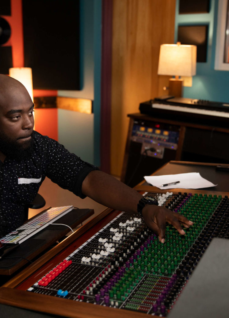 A sound engineer using the mixer in a recording studio