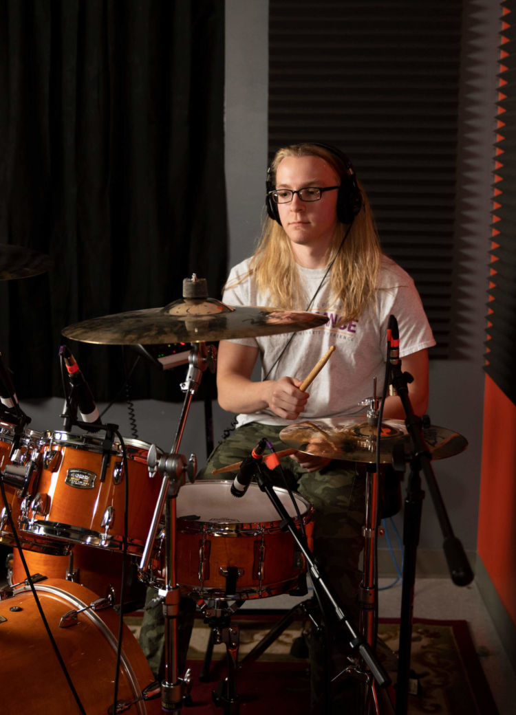 A drummer playing a drum kit